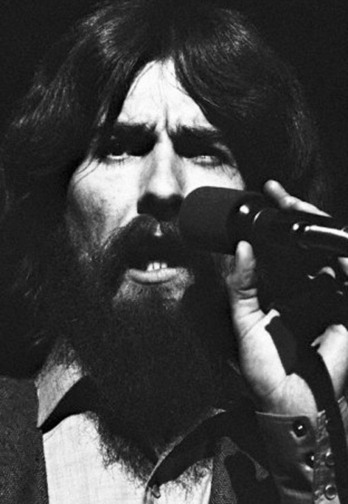 George Harrison Singing in Concert